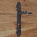 klamka do drzwi dłoń ozdobna